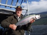 "The ""Dinkmeister"" with his biggest rainbow of the trip. The 11 LB. beauty was slid back into the water after this pose."