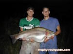 The twins, Adam and Sean Konrad pose with the 43.6 pound rainbow trout...